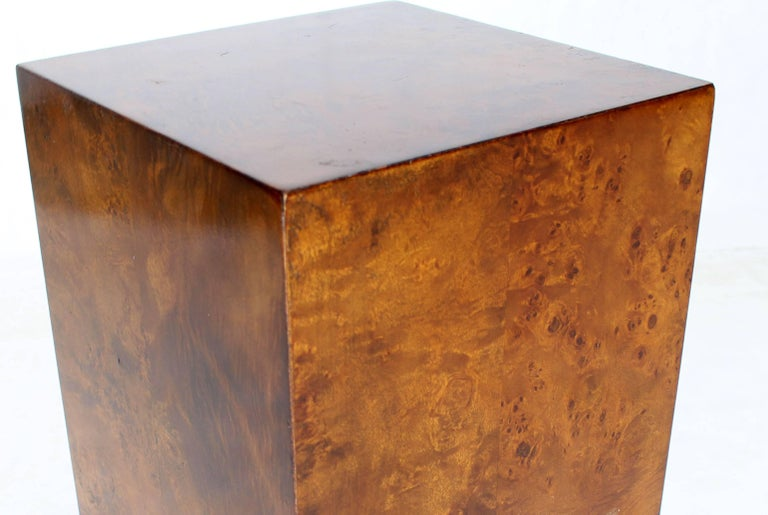Mid-Century Modern burrowed square pedestal.