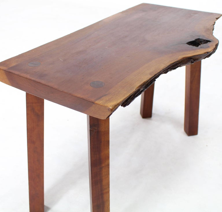 Mid-Century Modern organic walnut medium size bench or side table.