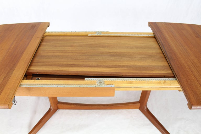 Hard to find all solid teak Danish modern dining table with two self containing 20