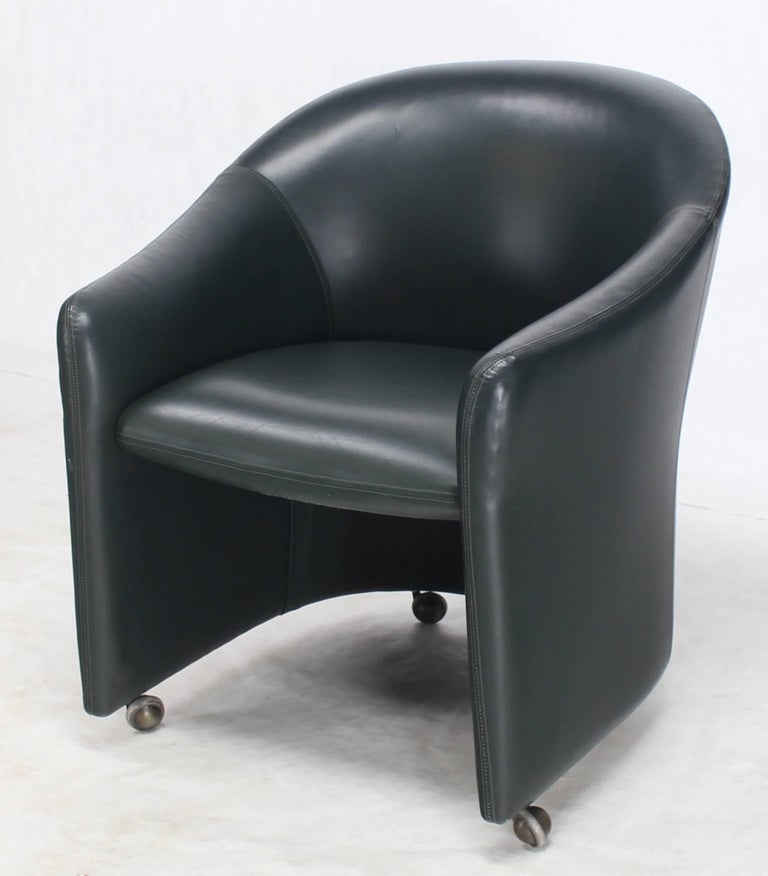 American Set of Four Leather Barrel Back Chairs on Wheels For Sale