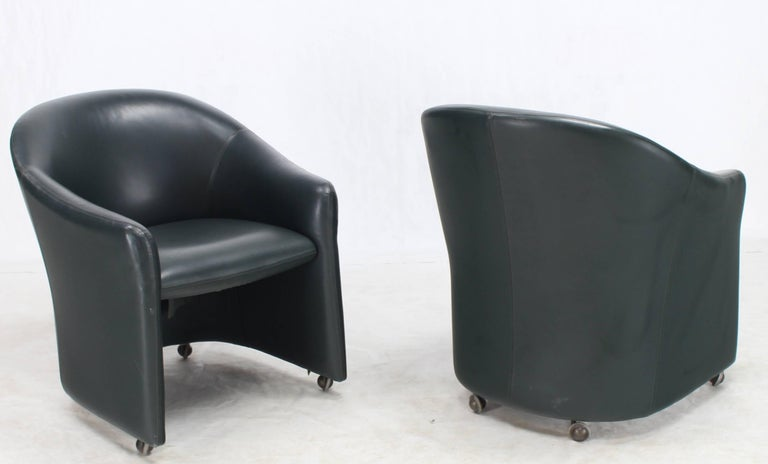 Mid-Century Modern Set of Four Leather Barrel Back Chairs on Wheels For Sale