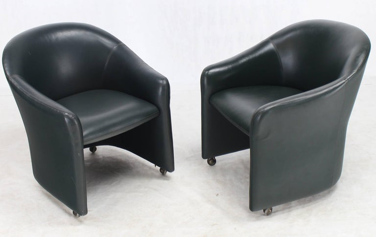 Set Of Four Leather Barrel Back Chairs On Wheels For Sale
