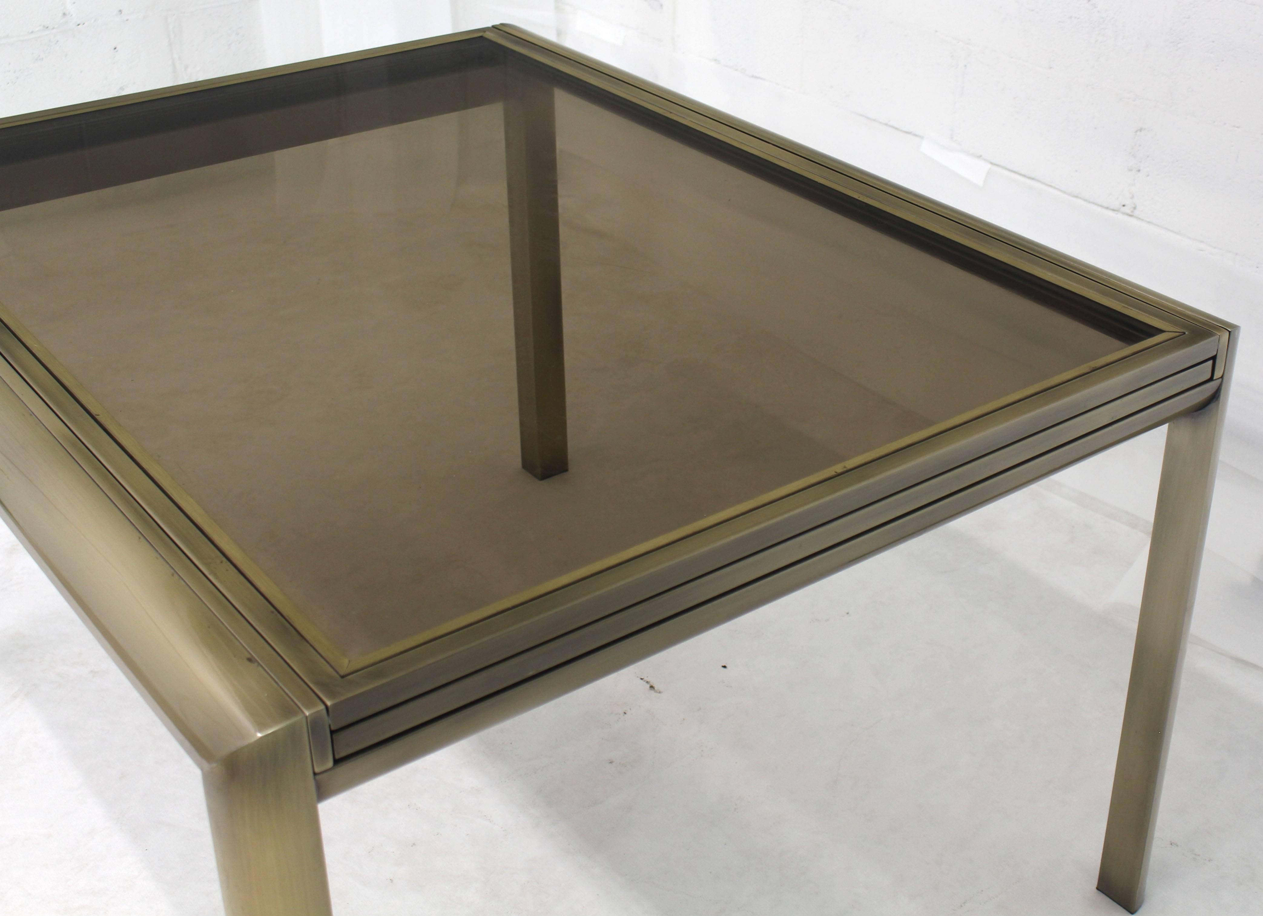 Mid Century Modern Expandable Dining Table In Brass And Bronze Glass.  Beautiful Original Condition