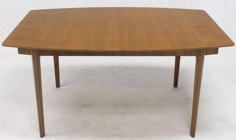 Solid mid century modern medium walnut dining table by Widdicomb. Two 18