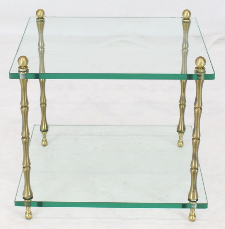 Mid-Century Modern thick glass cube shape side table connected with four brass faux bamboo rods and ball finials.