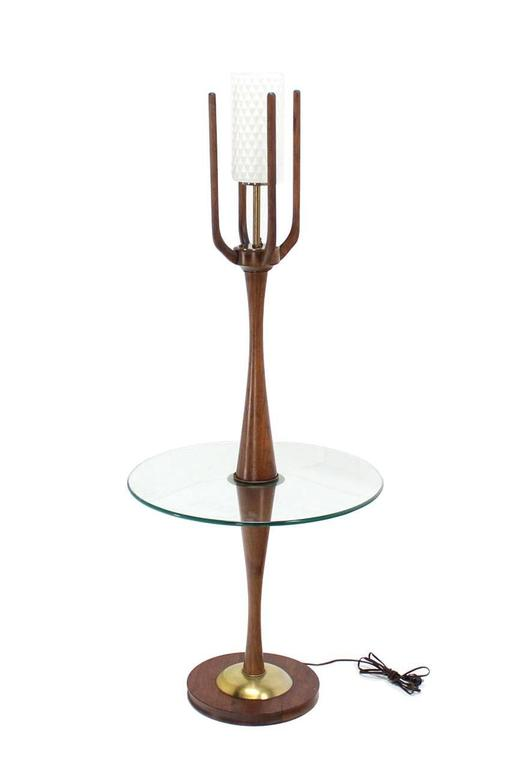 Very nice craftsmanship sculptural walnut floor lamp. Frosted glass cylinder shape shade. Turned walnut base.