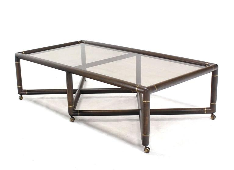 Double x base glass top rectangular coffee table on wheels for Glass top coffee table with wheels