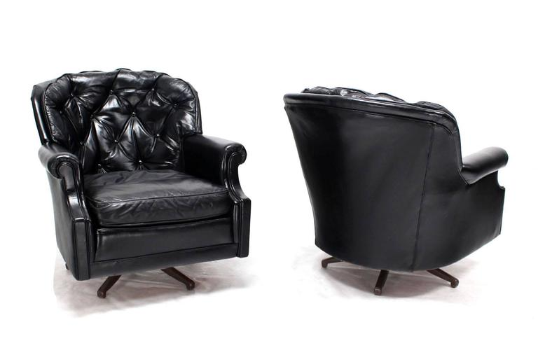 Pair Of Shiny Black Leather Swivel Barrel Back Lounge Chairs