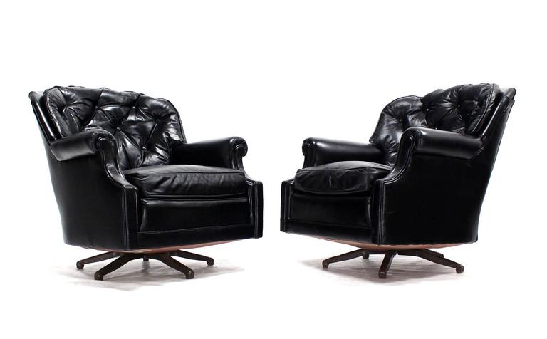Pair Of Shiny Black Leather Swivel Barrel Back Lounge