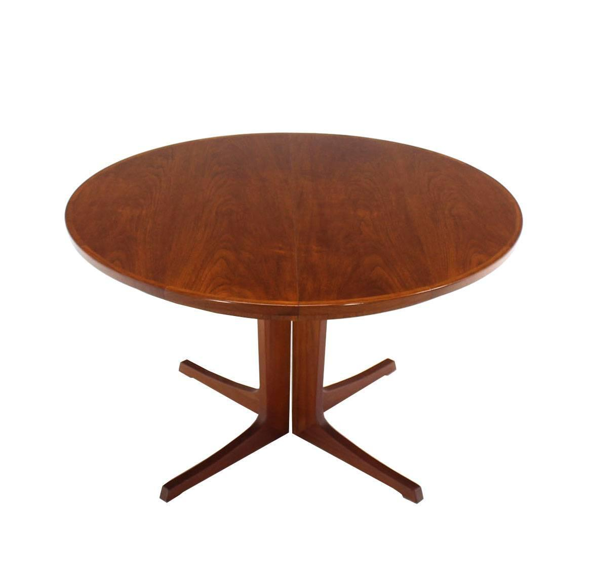 round danish mid century modern teak dining table with two leaves at