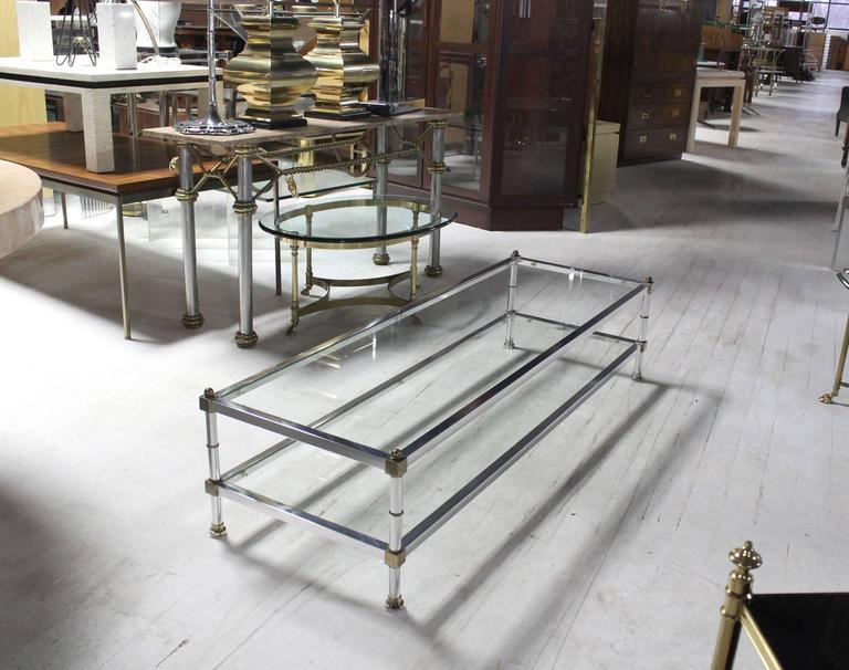Mid Century Modern brass chrome and glass two tier coffee table.