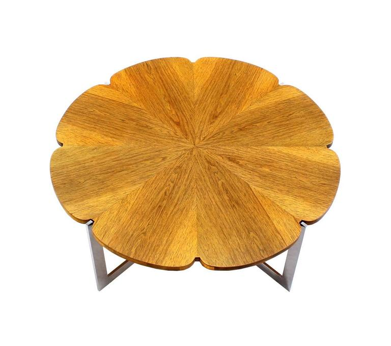 Daisy shape top X-base mid century modern coffee table. Very nice unusual design. Outstanding craftsmanship.