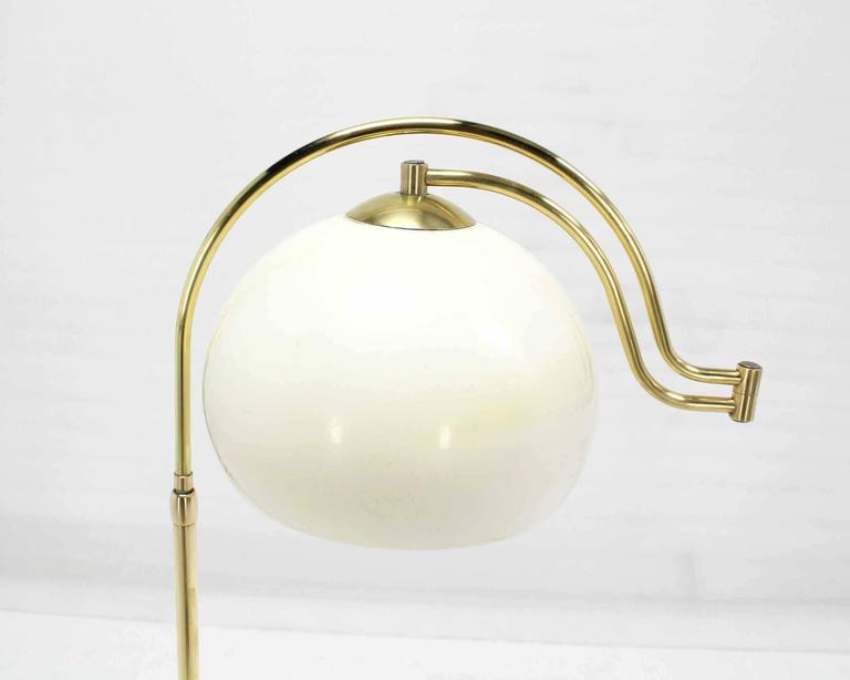Polished Fully Adjustable Mid Century Modern Brass Base Floor Lamp Globe Shade For Sale