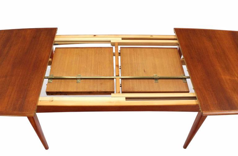 Danish Modern Teak Boat Shape Dining Table With Two PopUp Leafs - Danish modern dining table with leaves