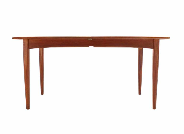 20th Century Danish Modern Teak Boat Shape Dining Table With Two Pop Up  Leafs Extension