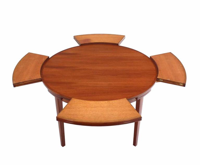 modern teak round expandable top dining table is no longer available