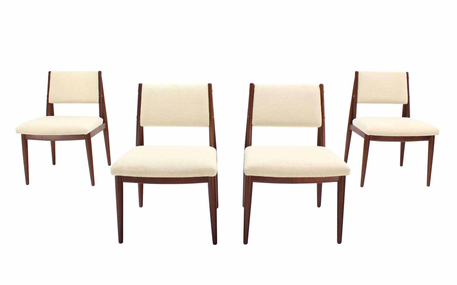 Set of four danish mid century modern dining chairs with new seats at