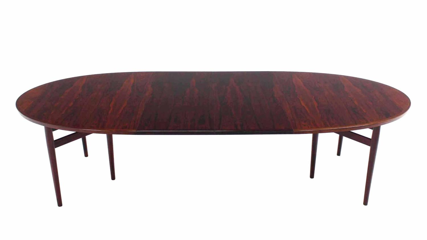 nice oval danish modern rosewood dining table with 2 x 19 leaves