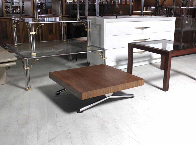 "Unusual splay leg Mid Century Modern style walnut top square coffee table. Measures: 32 x 32""."