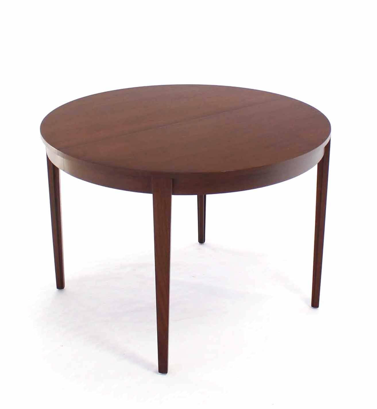 round dunbar dining table with four extension leaves for