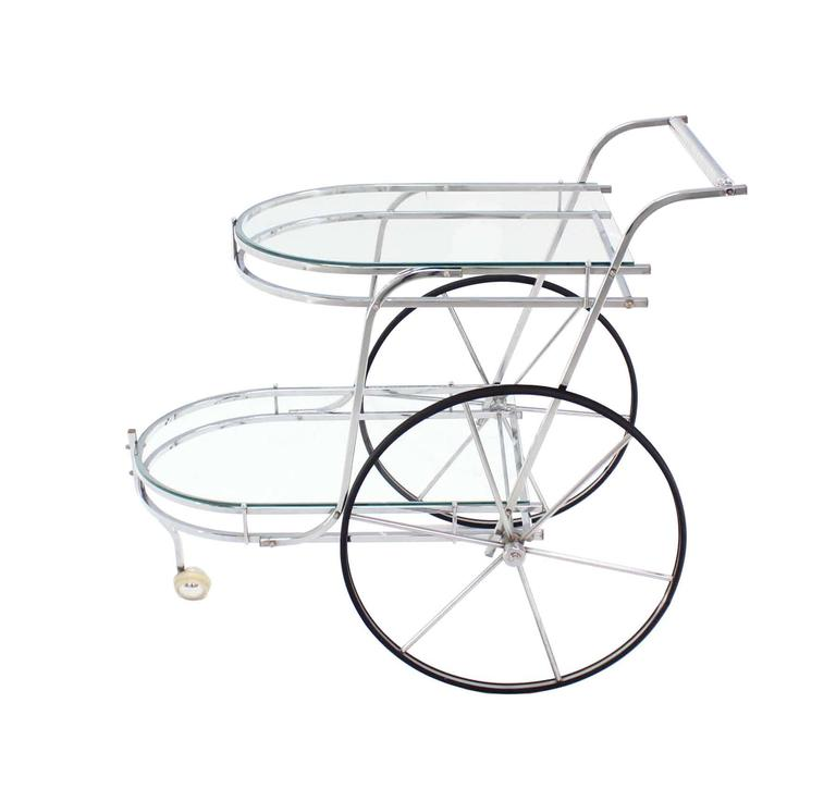 Nice Mid-Century Modern polished chrome and glass rolling bar tea cart.