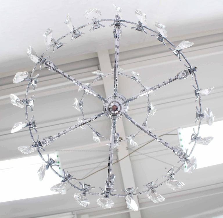 Nice Mid-Century Modern round chrome and crystal light fixture chandelier.