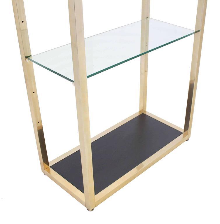 Mid-Century Modern glass shelves and brass finish etagere.