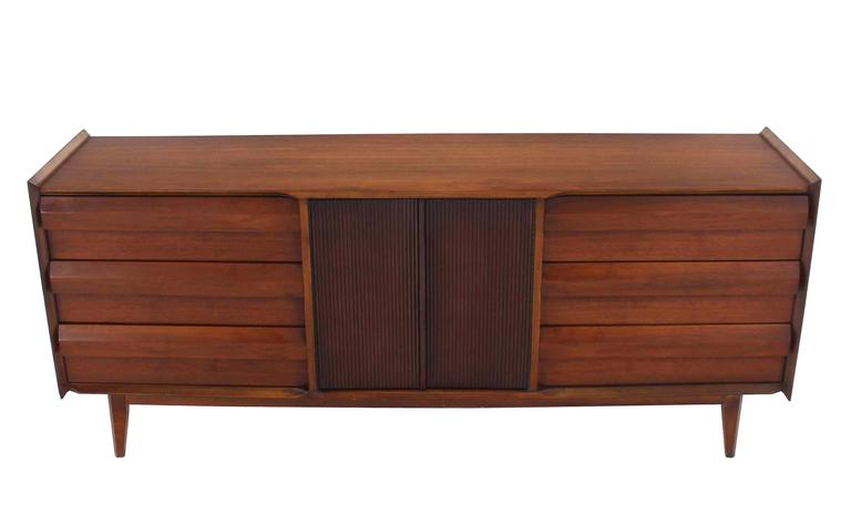 Very nice Mid-Century Modern long walnut credenza dresser with 6 Drawers and  fluted doors compartment.