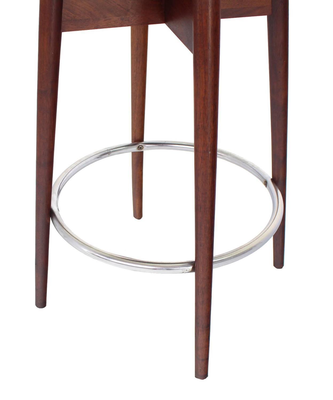 Three mid century modern walnut bar stools at 1stdibs