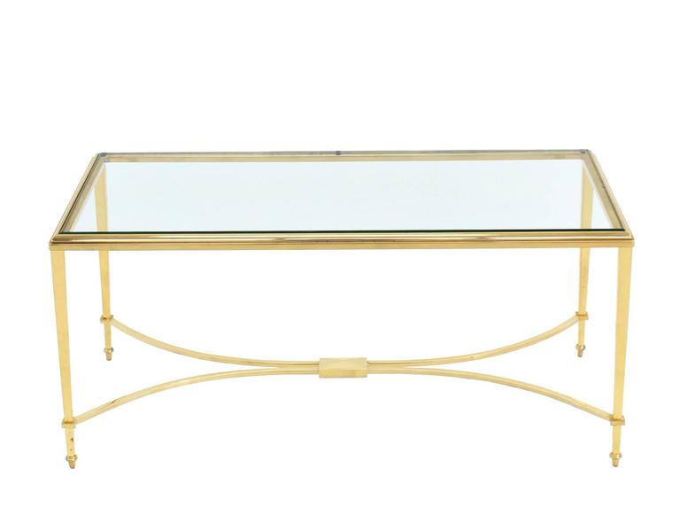 Gold tone brass Mid-Century Modern rectangular coffee table. Nice solid craftsmanship with nice weight to the brass base.