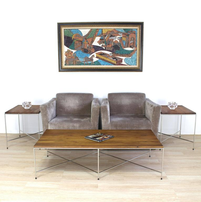 Established Lines, mid century modern decor, solid stainless steel double X-steel base cocktail table. Nice solid oiled walnut finish acacia top. The table features beautiful proportions, light design and excellent craftsmanship. Solid stainless