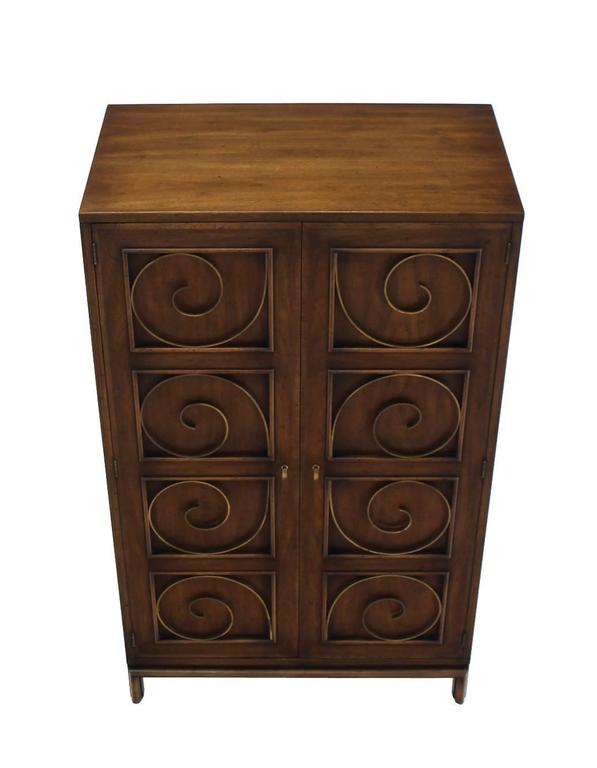 Very decorative high quality walnut finish blanket chest or cabinet with three drawers in style of Edmond Spence. The front doors are neatly decorated with solid brass scrolls.