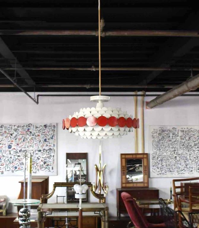 Mid-Century Modern painted red and white metal pendant shape light fixture.