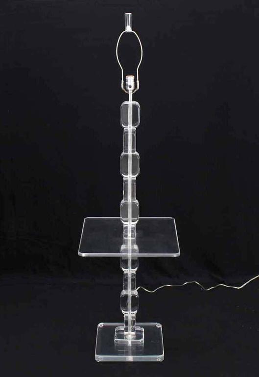 Very nice striking looking Lucite floor lamp, side table.