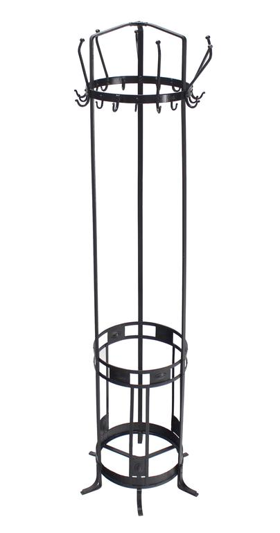 Very nice decorative black wrought iron coat rack umbrella stand.