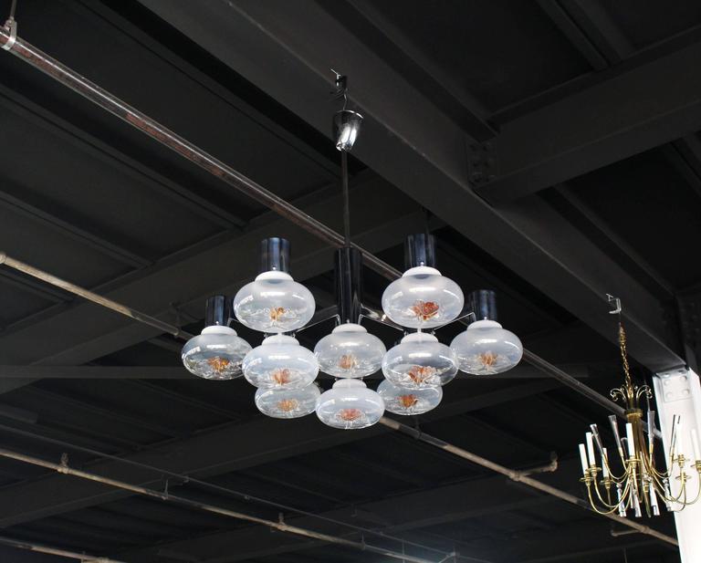 Very nice large chrome and beautiful Italian blown glass light fixture chandelier.
