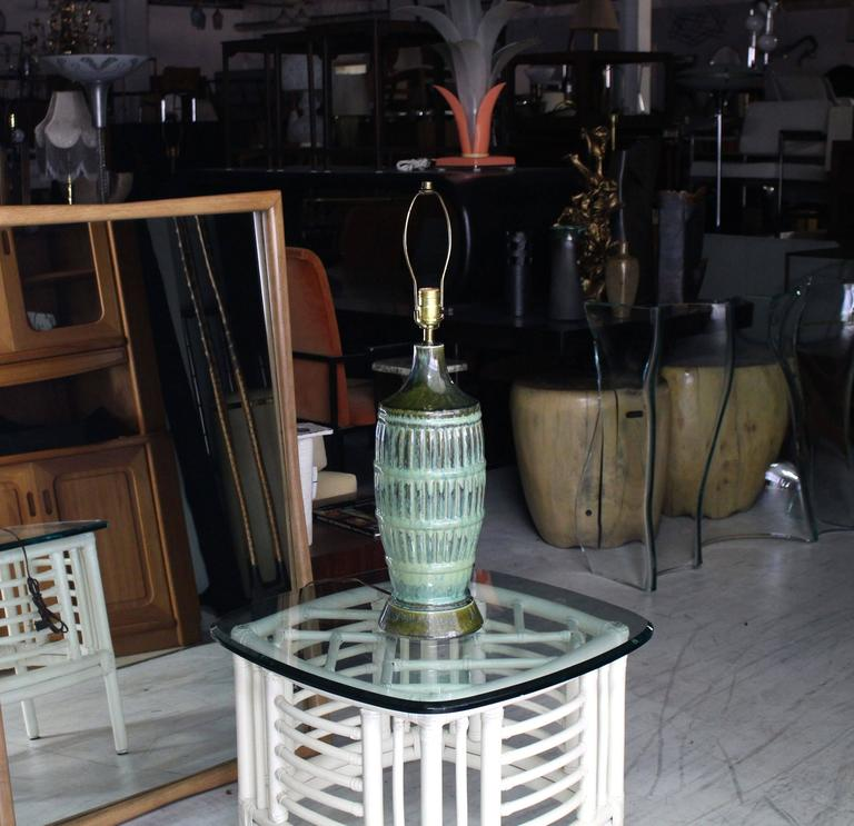 Very nice art pottery turquoise olive green glaze table lamp. Fluted pattern.