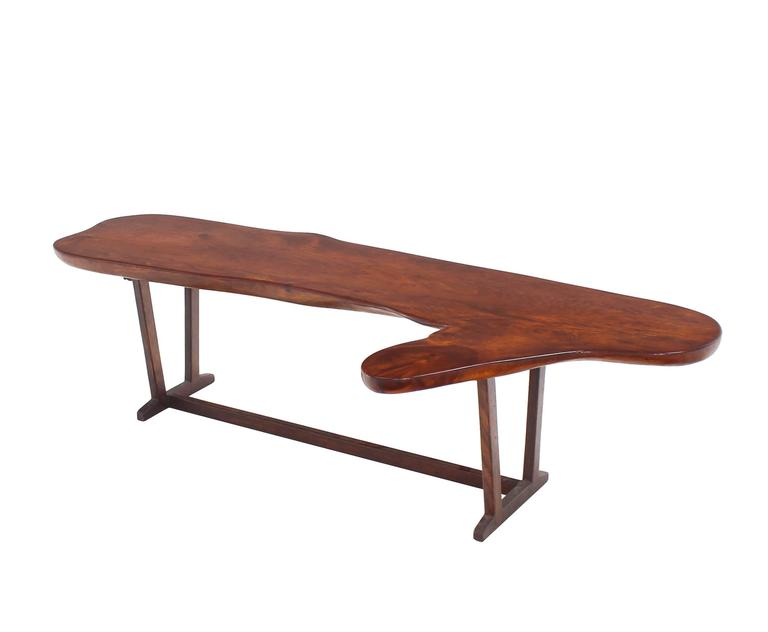 Very nicely built organic shape coffee table or bench. Nice thick solid wood top.