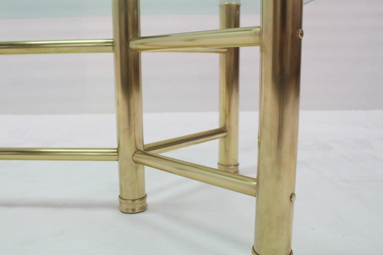 Mid-Century Modern six legged solid brass tube coffee table.