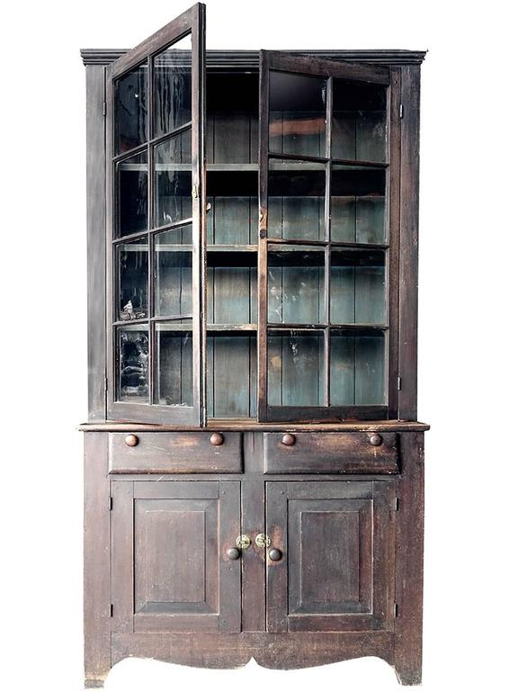 This poplar cupboard came from a farmhouse in Scioto County, Ohio. It is entirely original except for one pane of glass. The nicely warn paint and subtle colors make this example very elegant. The paint wear is in just the right places and the wavy