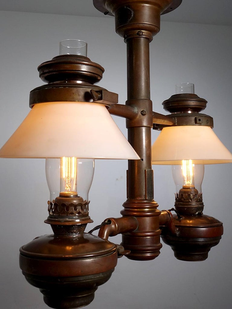 Few of these luxury class Victorian RR lamps still exist. Any remaining examples have found their way into museums and RR car restorations. This is a beautiful original double chandelier still retaining its original milk glass shades. An interesting