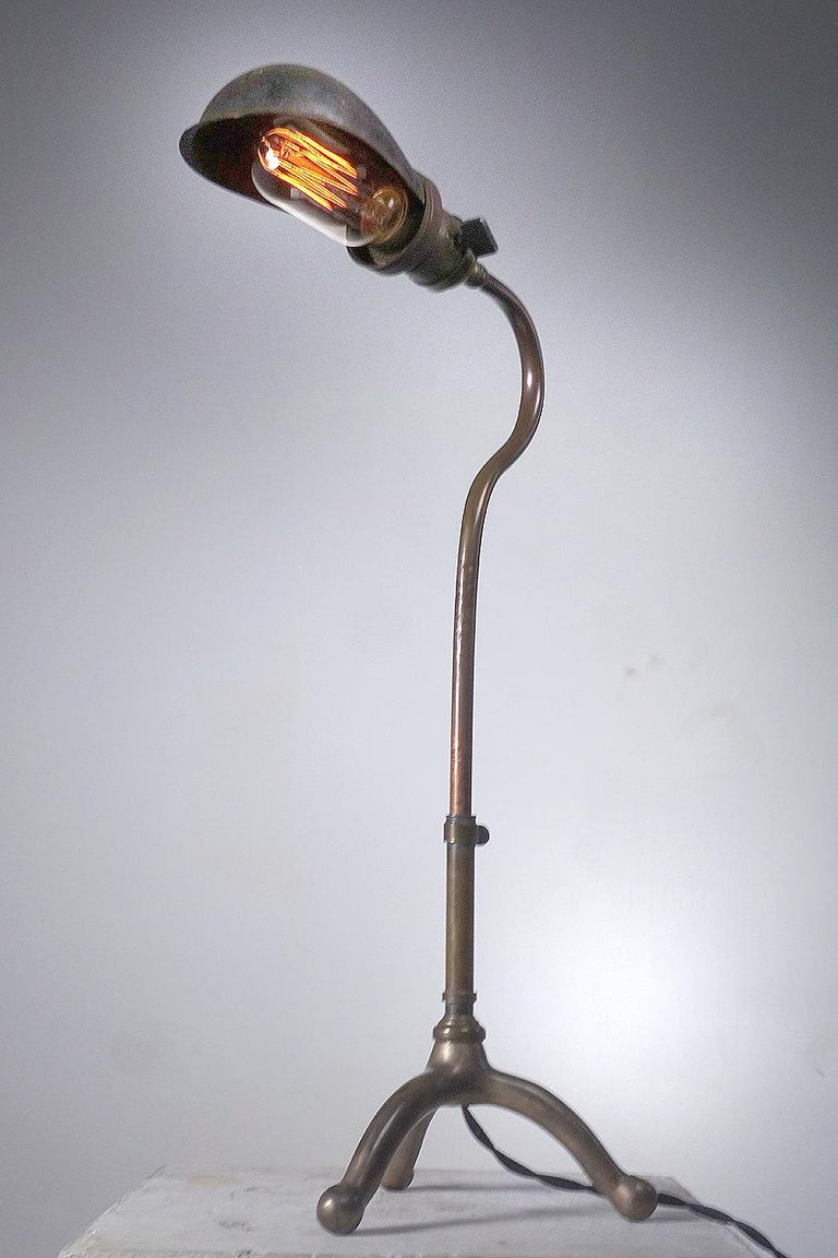 These rare early adjustable industrial desk lamps date to the turn of the century. The lamp is Faries and the shade is an original signed Hubble. They are simple, elegant and have just the right look.
