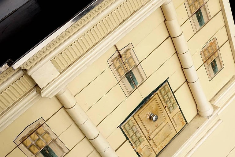 This is a rare piece of Americana. It's an architectural house form dental cabinet with classical columns disguising multiple drawers. It was designed for childrens' dentist offices to calm their fears. The American dental cabinet company produced