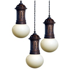 Bun Shaped Vaseline Pendents in Vented Copper Fixture