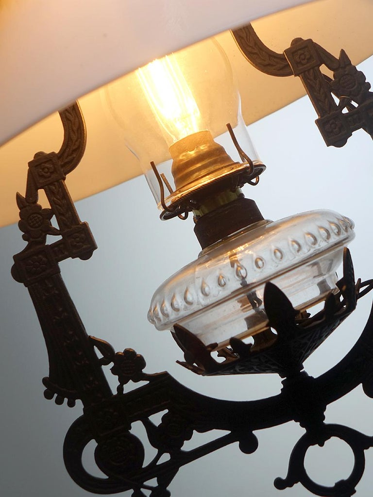 This is a nice working chain drive Bradley and Hubbard oil lamp. It was electrified keeping its original Victorian character. The drop is 42 inches and can pull down to over 56 inches. This type of lamp always looks interesting hanging low over a