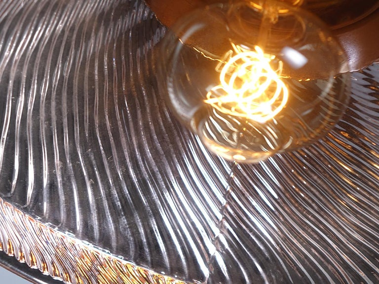 These huge and rare mercury glass reflectors are not common and the shape on these have just the right look. With a diameter that is over 13 inchs they are one of the largest shades made by the X-Ray Lamp Co. The outside is a gold finish and the
