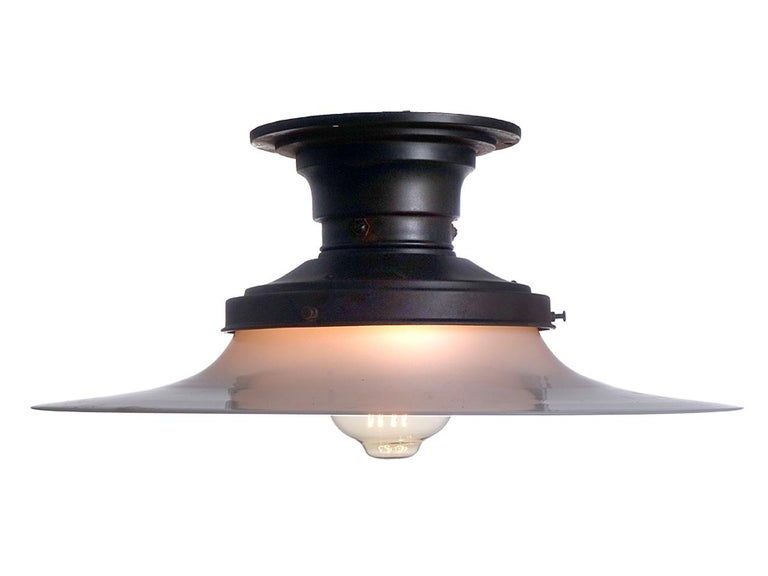 We do have a pair of these in stock but have priced them per lamp. This way you can buy just one or both. These lamps are my favourite early flush mount fixtures. In fact I have a set just like this lighting my hallway at home. The lamp is very