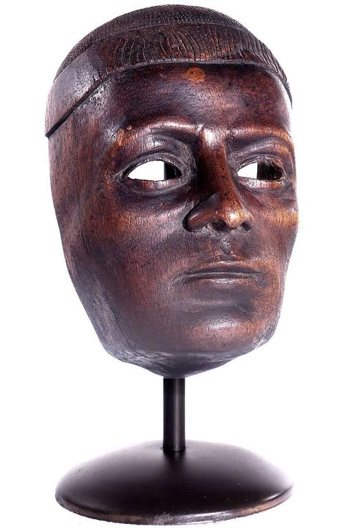I would date this sculpture to the turn of the century. This study/mask was created by a very accomplished artist. The quality of carving and details make this one special.
