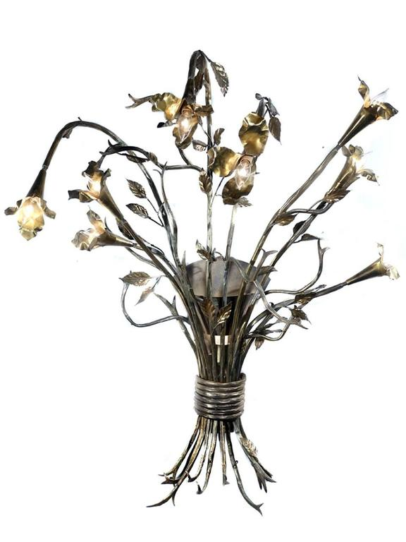 These larger than life sconces are measures over 40 inches tall and 3 foot wide. Each lamp has eight flowers with candelabra bulbs and a ninth back light at the center of the bouquet. It was quite a job but everything is now freshly rewired. These