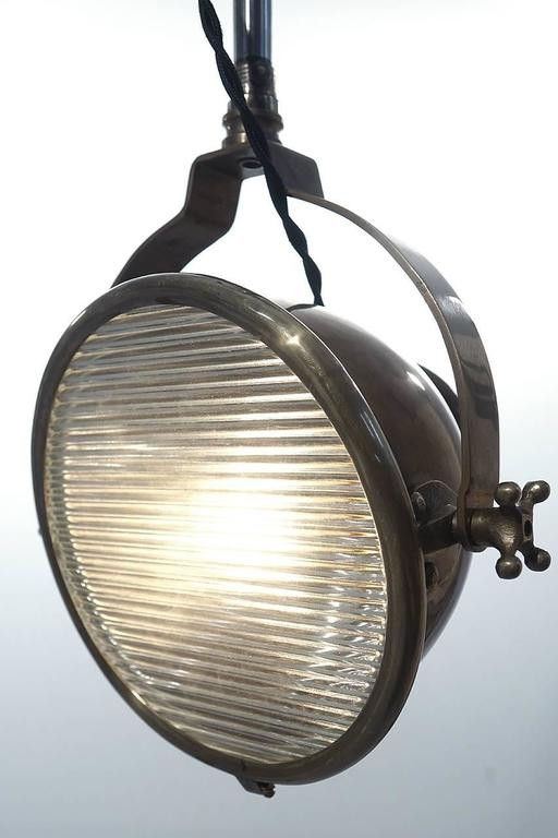 This medical arm spot light has a very unique Industrial look. The spotlight head was used as a dental exam light. It takes a standard bulb, has a prismatic lens and is perfect as a reading lamp.